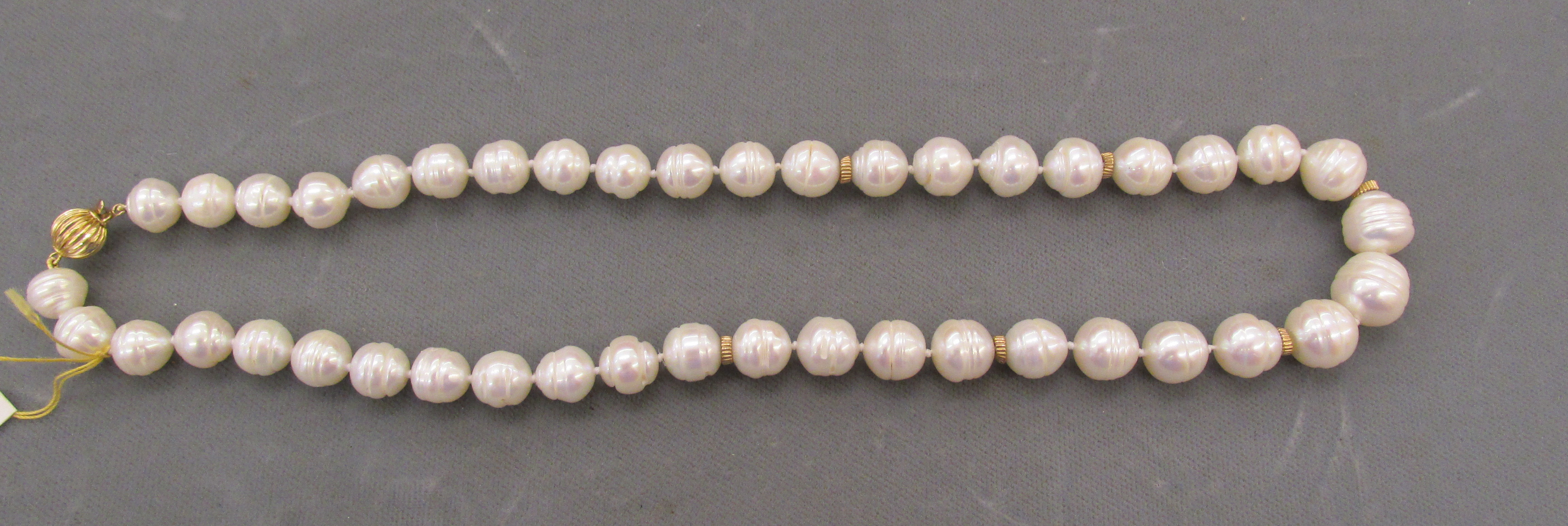 7mm x 10mm White Baroque Pearls Strand 18