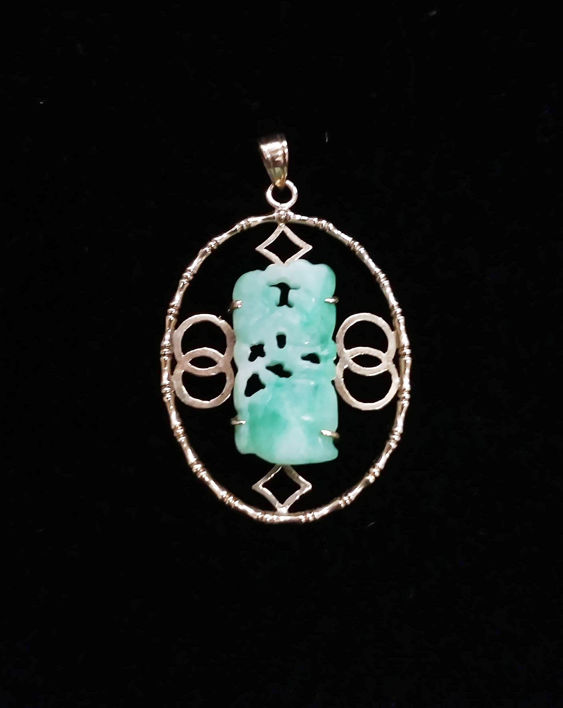 14kt Yellow Gold Oval Shape Pendant with 4.74 Carat Carved Jade Center