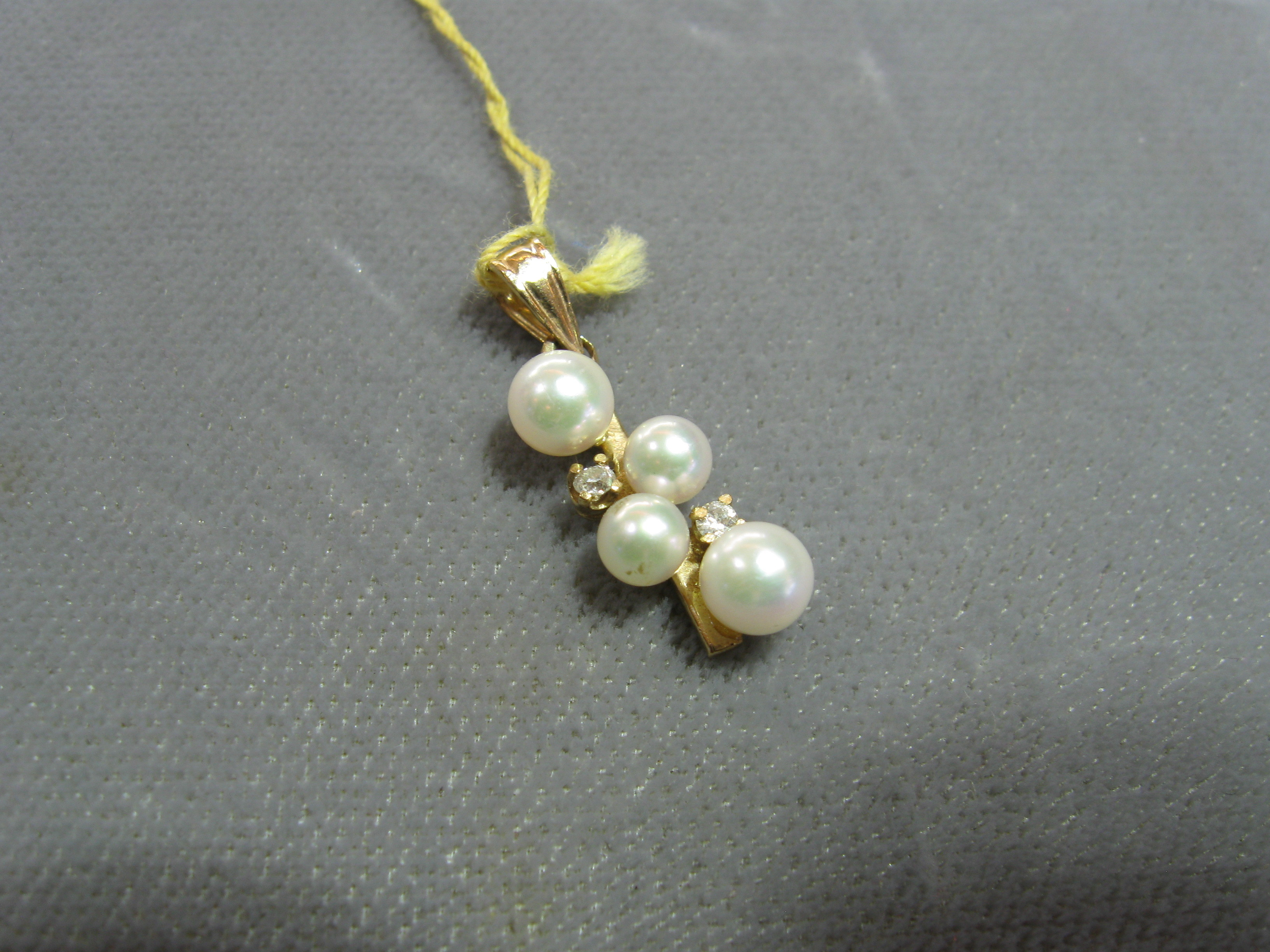 4 Round White Pearls and 2 Round Brilliant Cut Diamonds Set in 14kt Yellow Gold Pendant