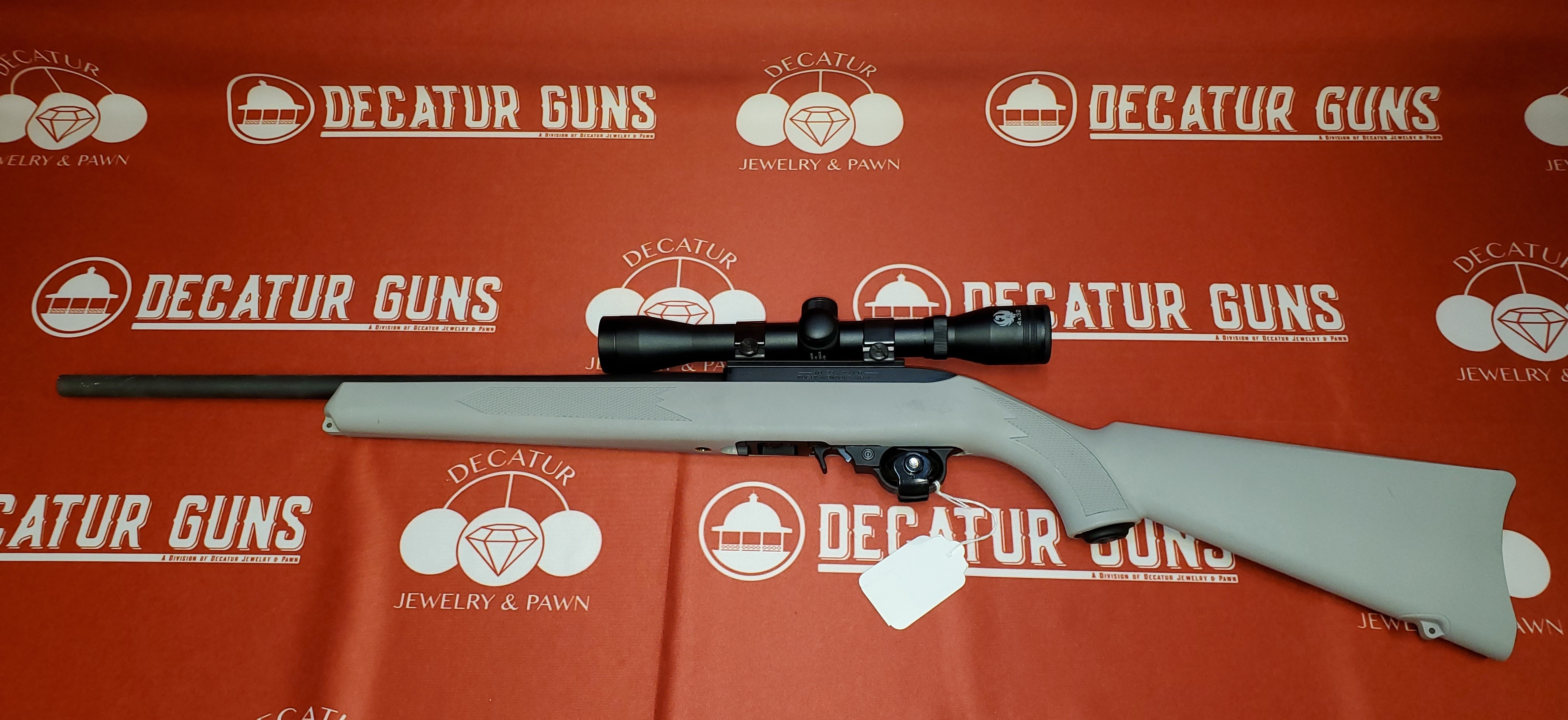 RUGER 10-22 RIFLE STOCKED IN GREY WITH RUGER 4X32 SCOPE